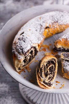 Strudel with poppy seeds on a vintage stand