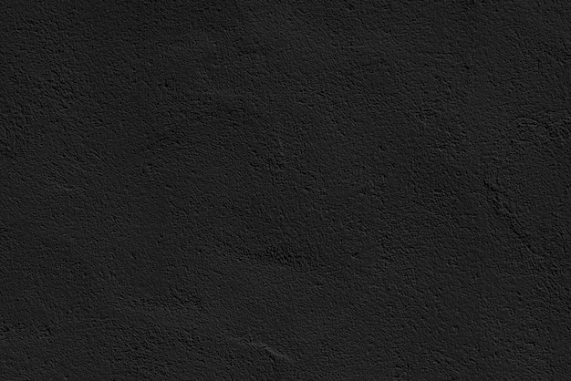 Stucco black wall of an old house abstract dark texture