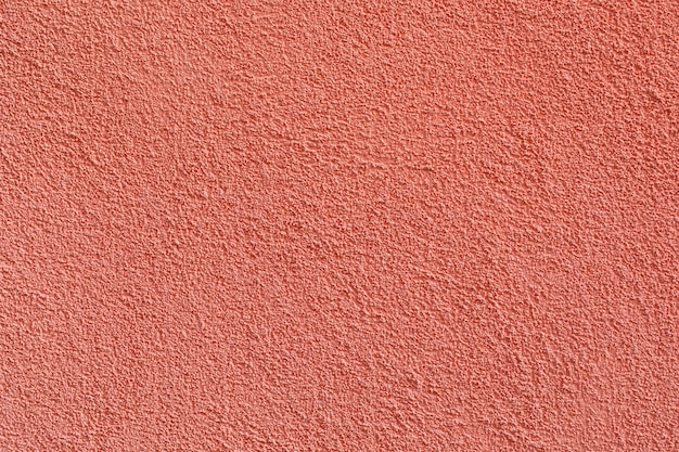 Stucco texture ocher color on the exterior walls of the houses.