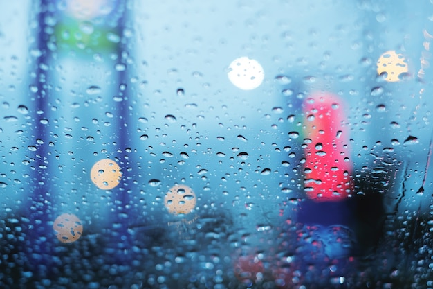 Stuck in traffic on rainy day, droplets on the windshield with blurry and bokeh background