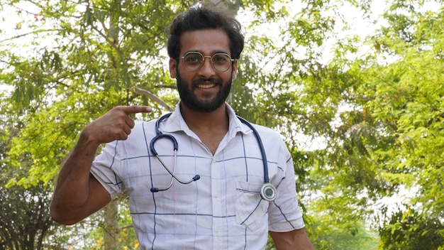 A student achieved scholarship in doctor education course or collage – student with stethoscope and showing success sign- medical education concept