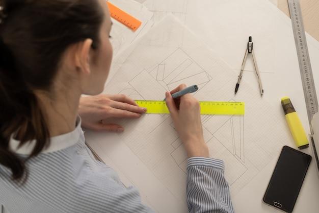 Student architect draws geometric shapes, design practice