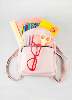 Student backpack and various school supplies. studying, education and back to school concept