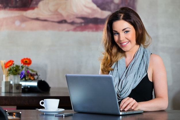Student or businesswoman working in cafe