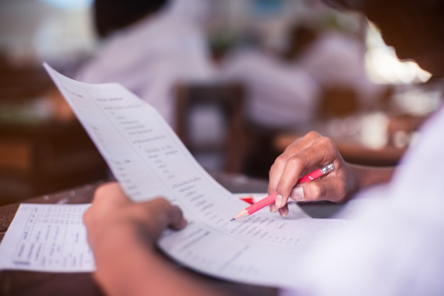 Student doing test in classroom