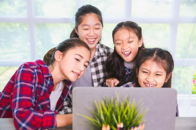Student girls enjoy studying and learning from computer notebook pc, back to school concept