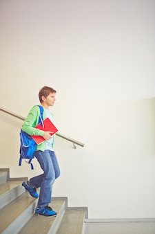 Student going down the stairs