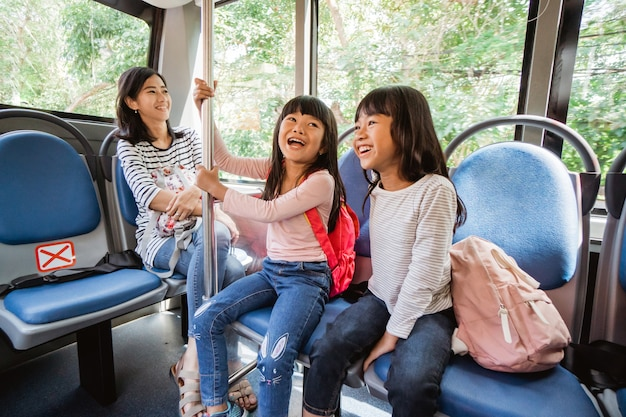 Student going to school by bus public transportation together