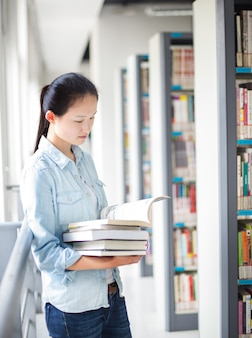 Student holding some books in the library