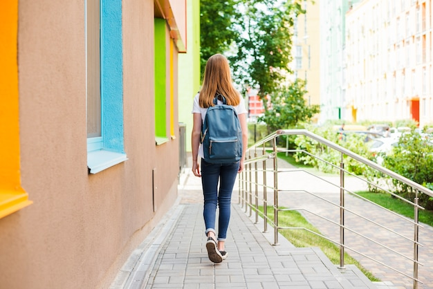 Student leaving school after classes Free Photo