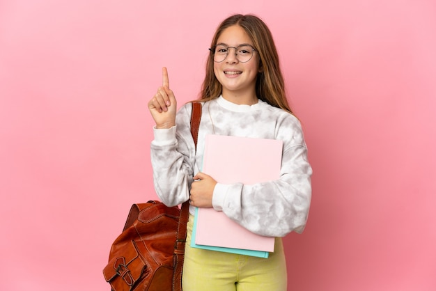 Student little girl over isolated pink background showing and lifting a finger in sign of the best