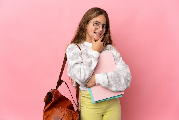 격리 된 분홍색 배경 행복 하 고 웃는 위에 학생 어린 소녀