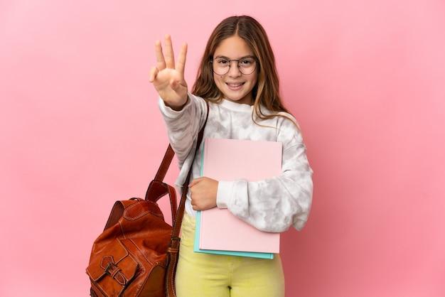 고립 된 분홍색 벽에 학생 어린 소녀 행복하고 손가락으로 세 세