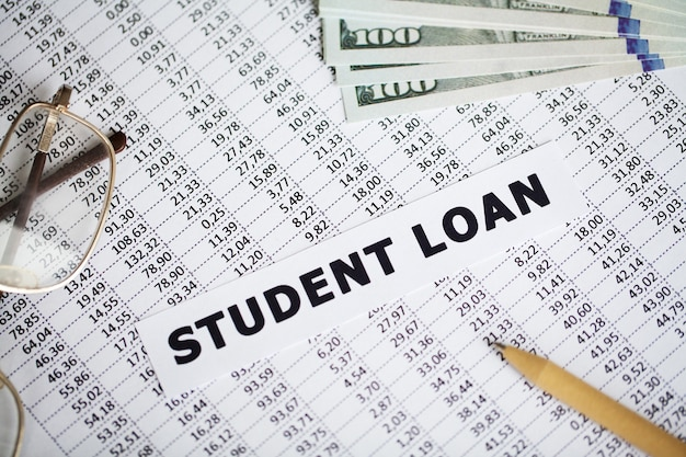 Student loan written on white card