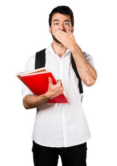 Студент, прикрывающий рот