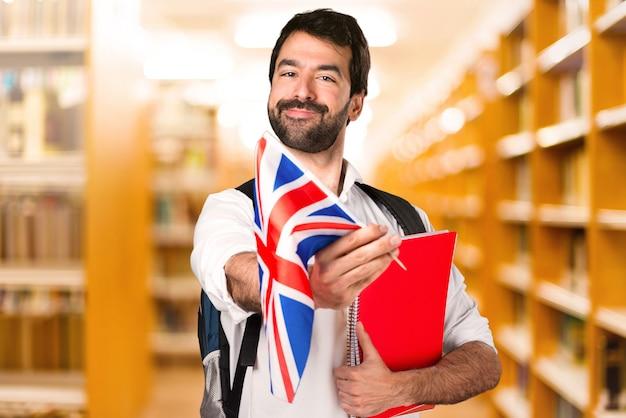 Student man ___ on defocused library
