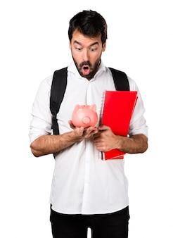Student man holding a piggybank