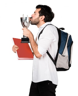 Student man holding a trophy