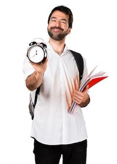 Student man holding vintage clock