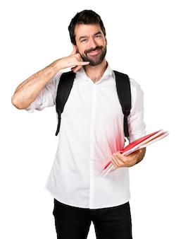 Студент, делая телефонный жест