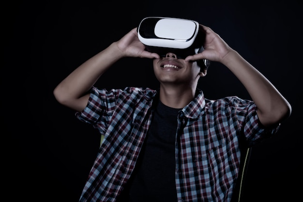 Student man wearing virtual reality goggles, vr headset.