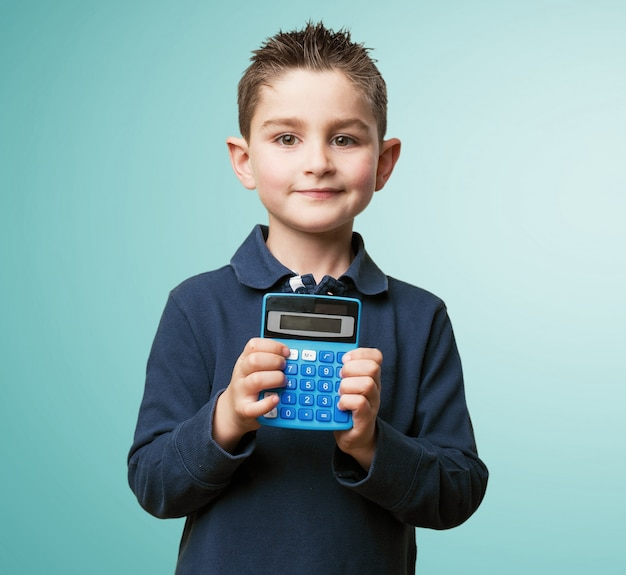 Student posing with calculator