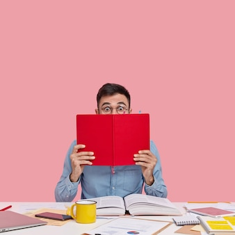 Student sitting at desk with documents