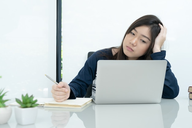 Student sitting in living room and learning online