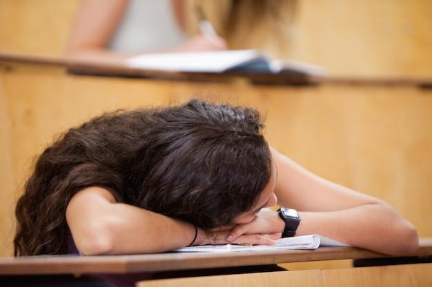 Student sleeping on her desk