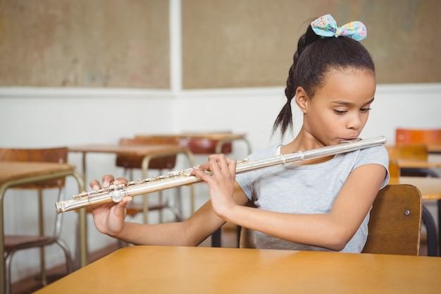 Student using a flute in class