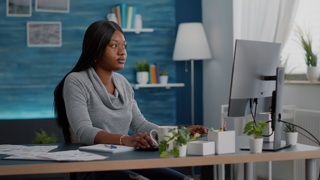 Student with black skin searching online courses writing school homework on on computer