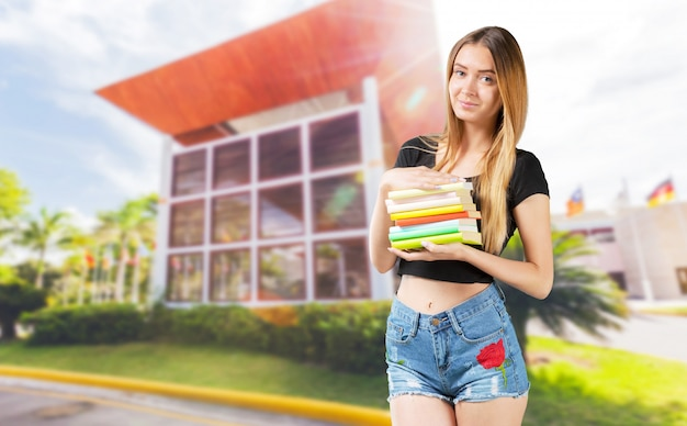 Student with books in hands