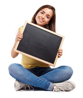 Student with crossed legs showing a chalkboard