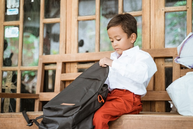 Student with indonesian school uniform getting ready to school in the morning