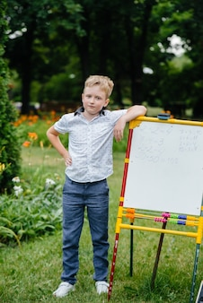 The student writes lessons on the blackboard and is engaged in outdoor training