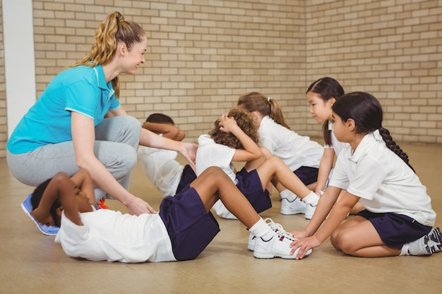 Students helping other students exercise