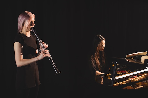 Students playing clarinet and piano