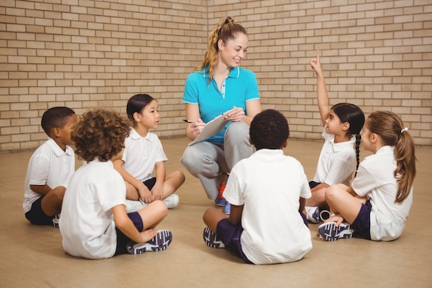 Students sitting and listening to the teacher