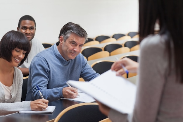 Students smiling in lecture