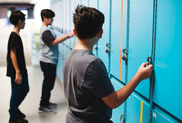 Students standing at the lockers