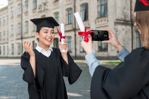 Students taking photo of each other at graduation
