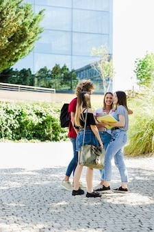 Students talking outside campus
