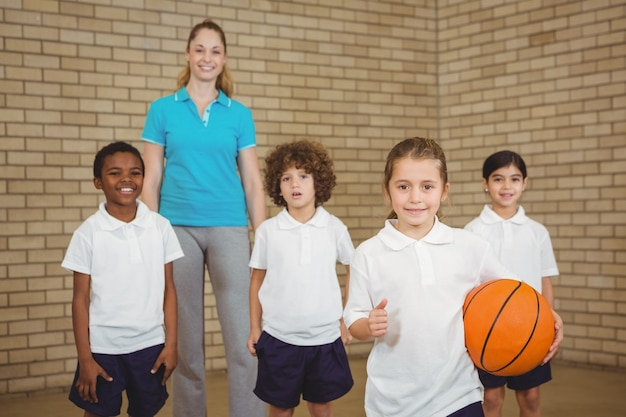 Students together about to play basketball