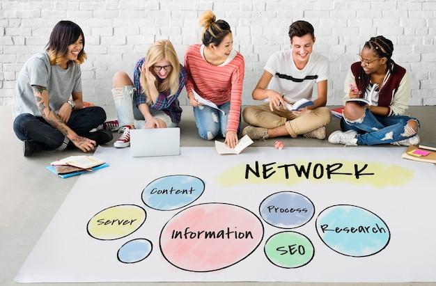 Students working on billboard network graphic overlay on floor