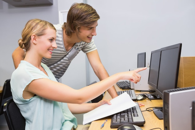 Students working on computer in classroom