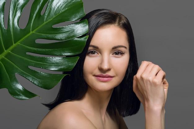 Studio beauty portrait of young brunette