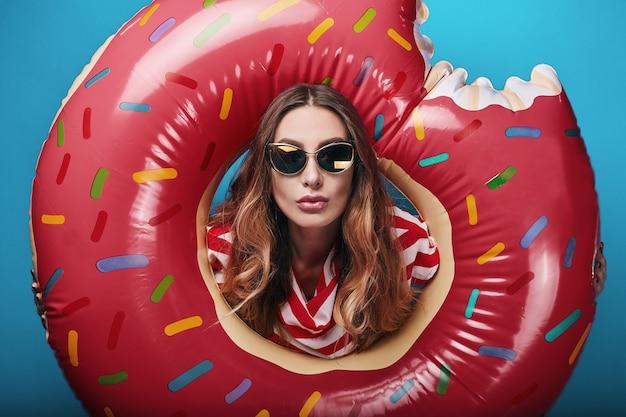 Studio bright summer fashion portrait of stylish beautiful woman