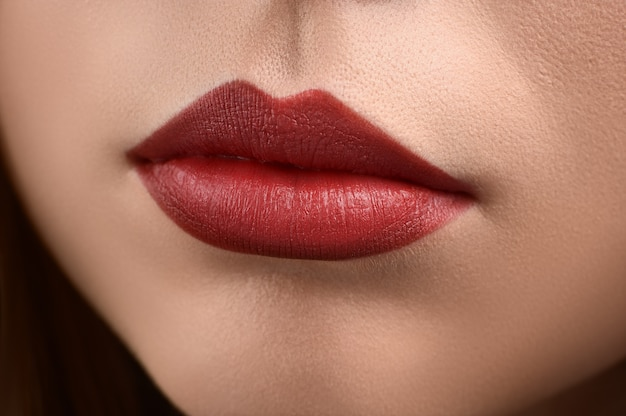 Studio close up of plump lips with make up.