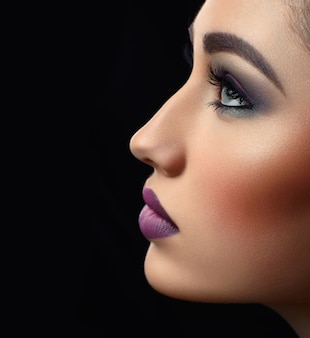 Studio close up of a profile of a beautiful fashion model