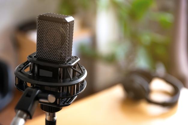 Studio condenser microphone and headphones, blur